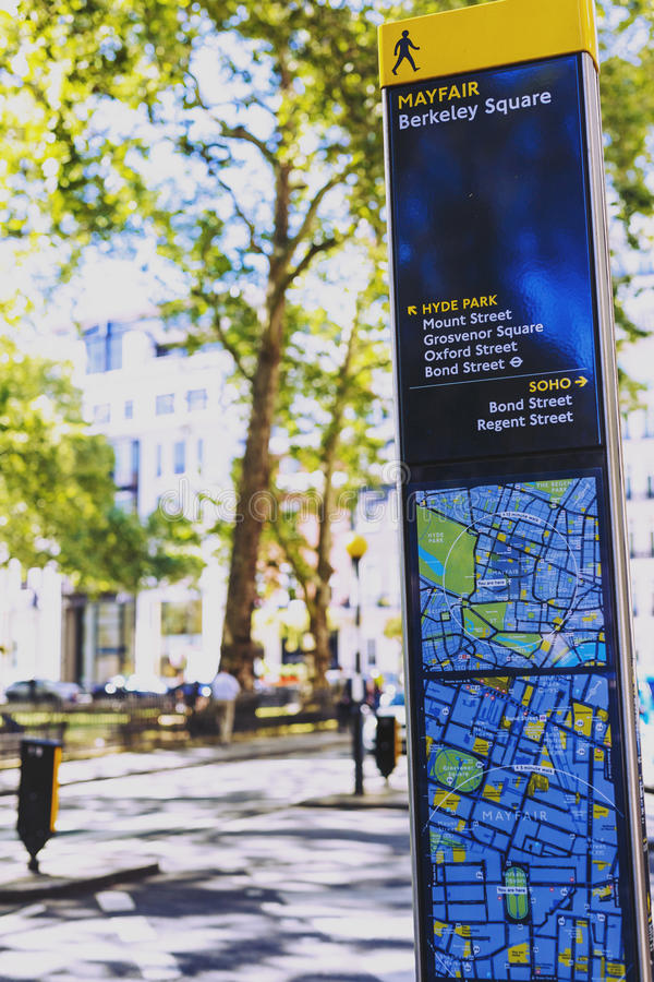 Mayfair road sign with map in London city centre. LONDON, UNITED KINGDOM - August 12th, 2016: Mayfair road sign with map and street bokeh in London city centre stock images