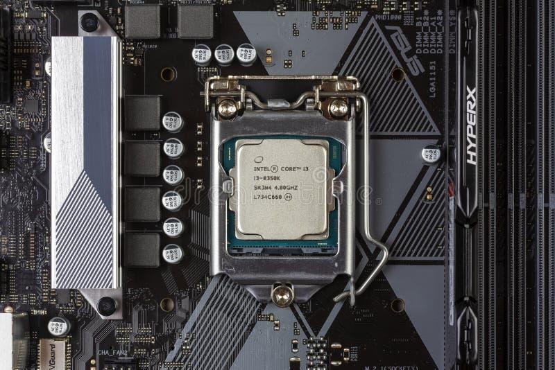 Intel core I3 desktop processor 8th gen and black DDR 4 DIMM 16 Gb Kingston HyperX Fury Memory RAM Module in the slot on the mothe stock image