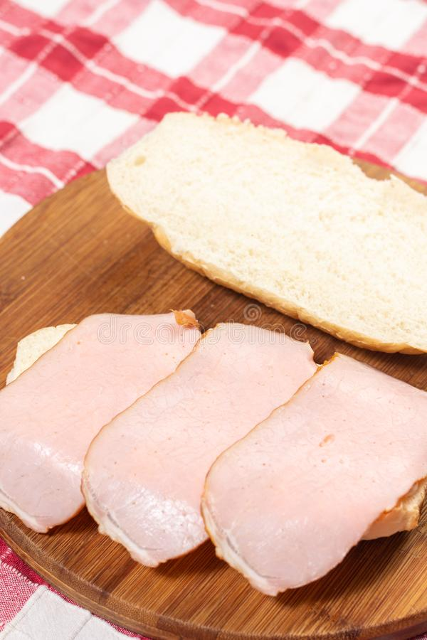 Mayonnaise and Ham on the sandwich bread on the wooden board. Tomato, food, snack, vegetable, fresh, lunch, lettuce, breakfast, meal, healthy, meat, cheese royalty free stock photo