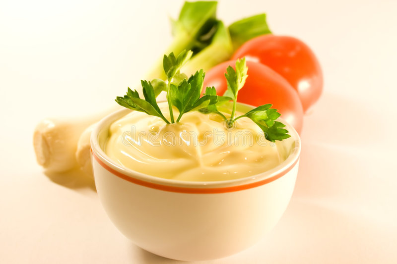 Mayonnaise and parsley twig stock images