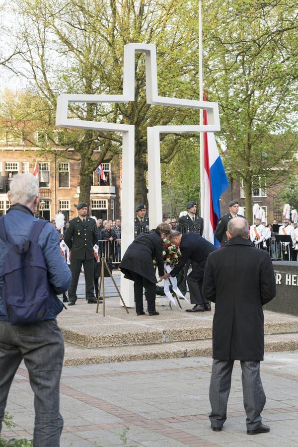 Mayor Peter van der Velden laying flowers. DORDRECHT - THE NETHERLANDS - MAY 4 2017: Mayor Peter van der Velden laying flowers at war monument on Sumatraplein on stock image