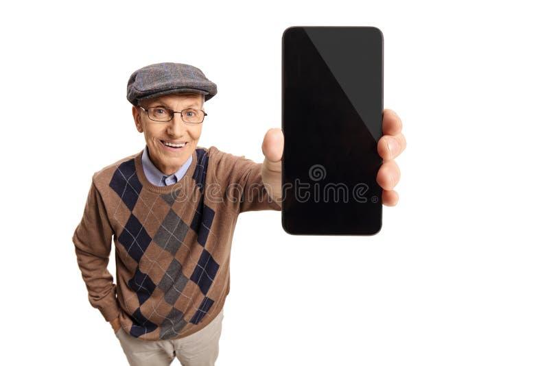 Mayor que muestra un teléfono imagen de archivo