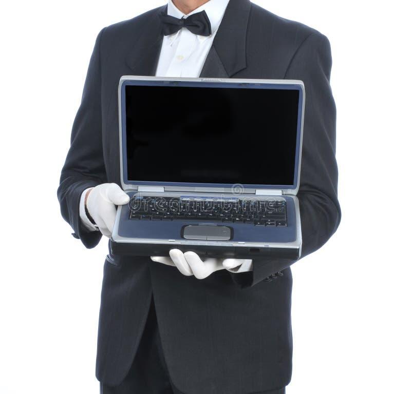 Mayordomo con la computadora portátil fotos de archivo libres de regalías