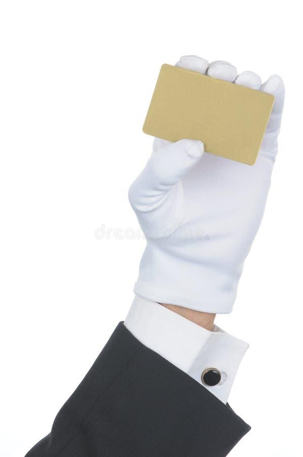 Mayordomo con la tarjeta en blanco del oro fotografía de archivo libre de regalías