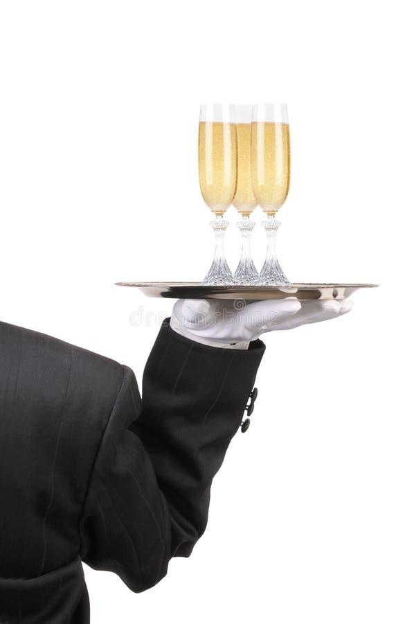 Mayordomo con los vidrios de vino en la bandeja fotos de archivo libres de regalías