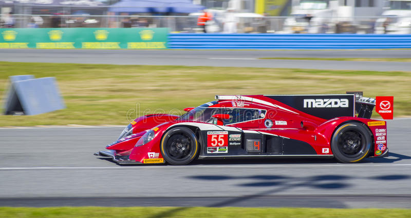 Mazda DP prototype race car at Daytona Speedway Florida. The Mazda DP prototype practices for the 2016 Rolex 24 hours of Daytona at the Daytona Speedway in stock photography