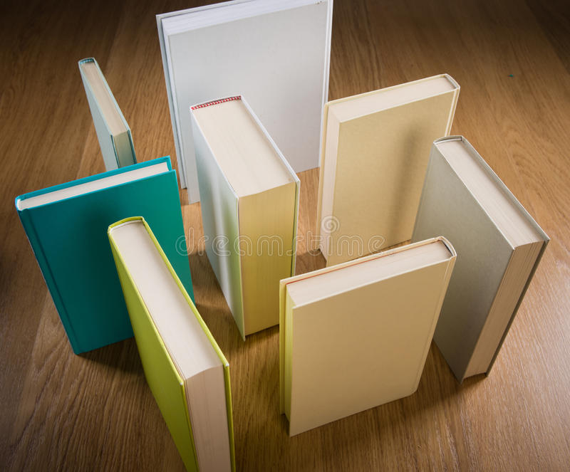 Maze of books. Standing books on floor composing a maze, learning and thinking concept stock images