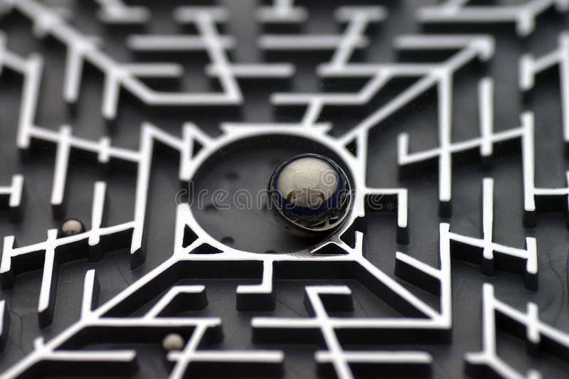 Maze Puzzle. Closeup of a maze puzzle with ball bearings stock photo