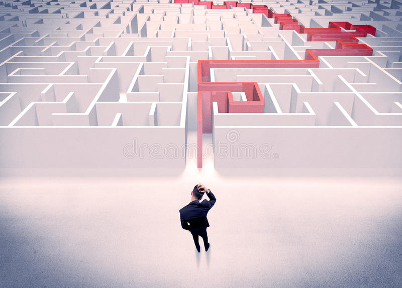 Maze solved for businessman concept. A businessman in suit giving thumbs up in front of labyrinth with red line showing the way out stock images
