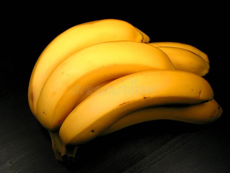 Mazzo della banana sul nero immagine stock