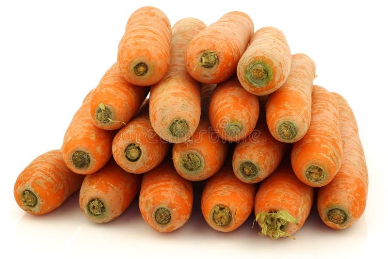 Mazzo di carote fresche impilate di inverno fotografie stock