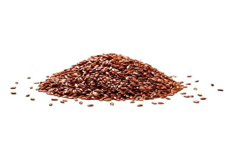 Mazzo di seme di lino su fondo bianco immagini stock