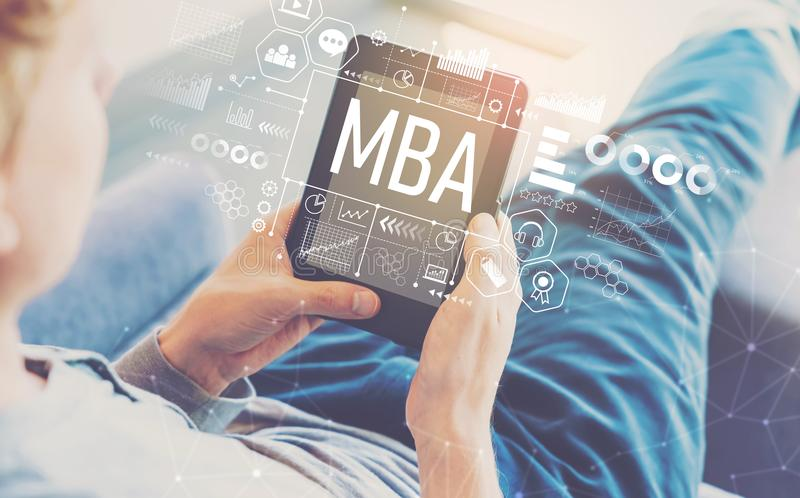 MBA with man using a tablet. In a chair royalty free stock photography