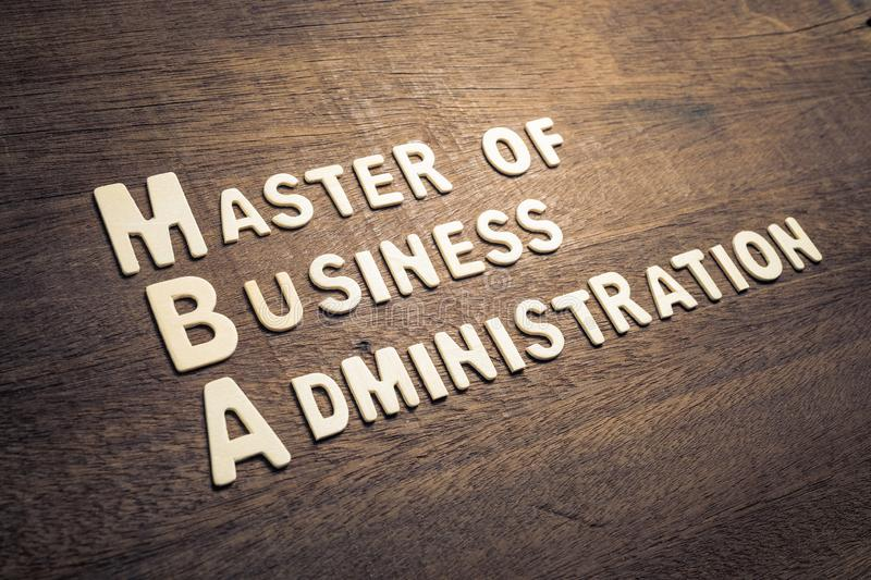MBA Text on Wood. MBA or Master of Business Administration text by wood letters arranged on wood background royalty free stock image