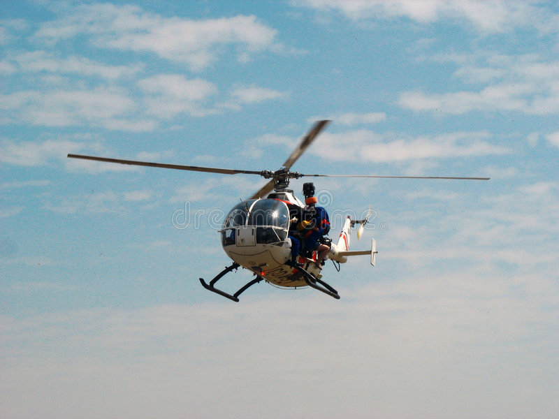 Mbb bo 105 helicopter. This is an mbb bo 105 helicopter of the philippine coast guard performing a search and rescue demo during an airshow in clark field stock photo