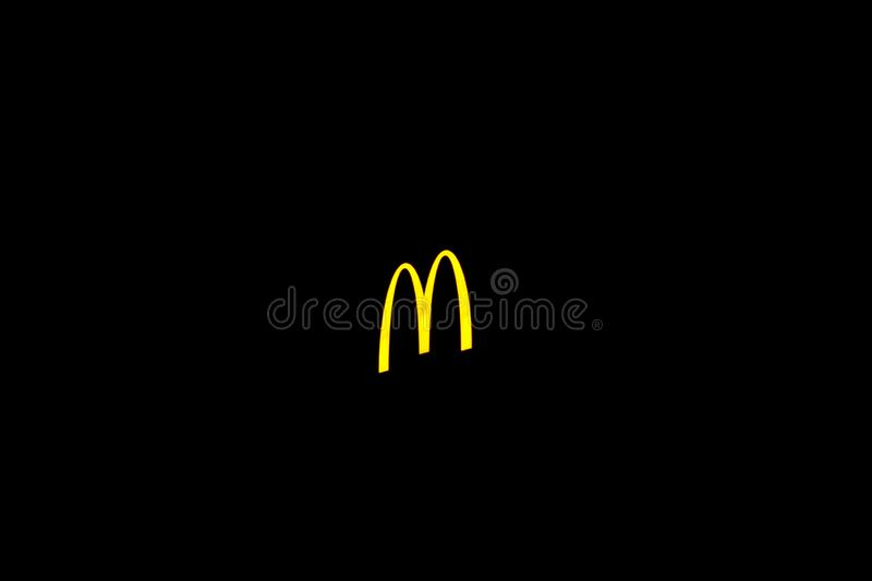 MC Donalds symbol and restaurant. Useable for any editorial use. Mc Donalds symbol of the big mc donalds restaurant chain stock images