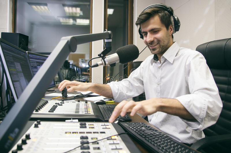 MC hosts the entertaining evening show. Radio anchorman hosts the program on air stock images