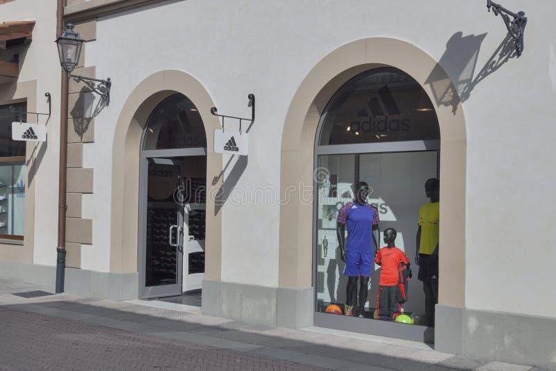 McArthurGlen Designer Outlet Barberino in Italy. Facade of Adidas store in McArthurGlen Designer Outlet Barberino situated in 30 minutes from Florence stock photo