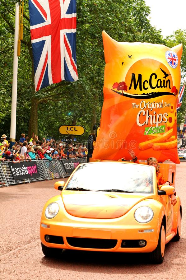 McCain. London, UK – July 7, 2014: Sponsors' caravan arrive at The Mall in London which hosted the third stage of the Tour de France royalty free stock image