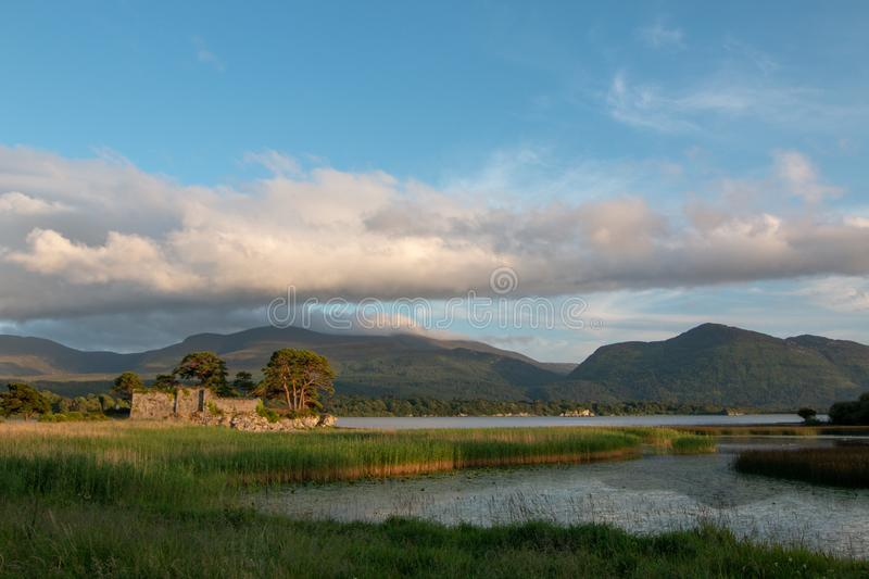 McCarthy Mor Irish castle ruins at Lough Leane on the Ring of Kerry in Killarney Ireland. Europe royalty free stock photography