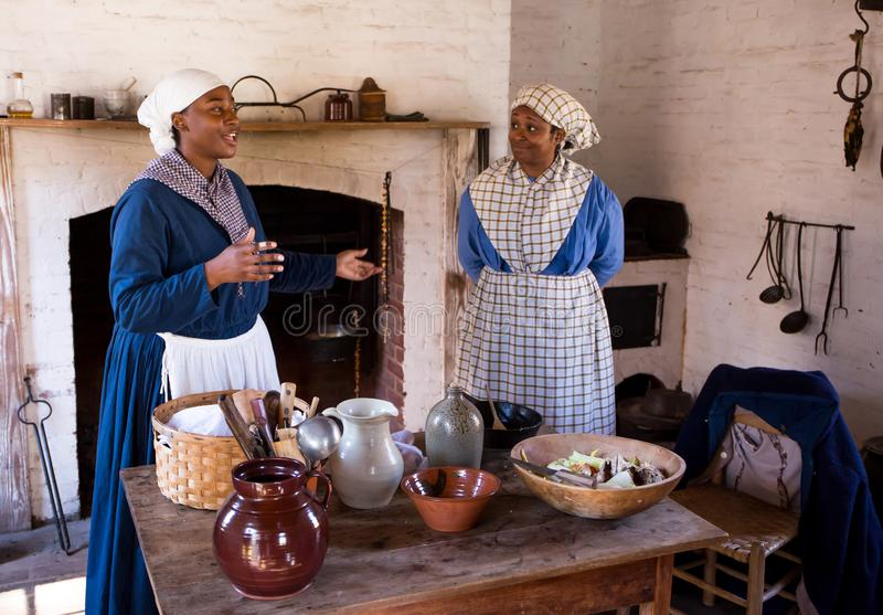 Teaching the Slave Experience at a Civil War Reenactment. MCCONNELLS, SC USA - November 3, 2018: African-American reenactors in period dress describe the lives royalty free stock photos