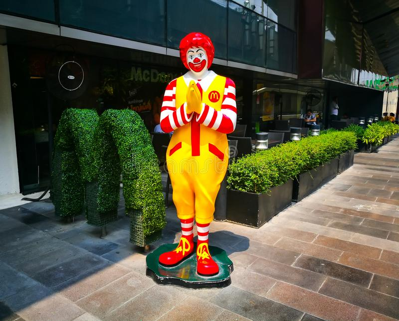 Mcdonald life size cartoon model branding icon standing at in front of restaurant with Thai traditional greeting style. BANGKOK, THAILAND. – On March 27 stock photos