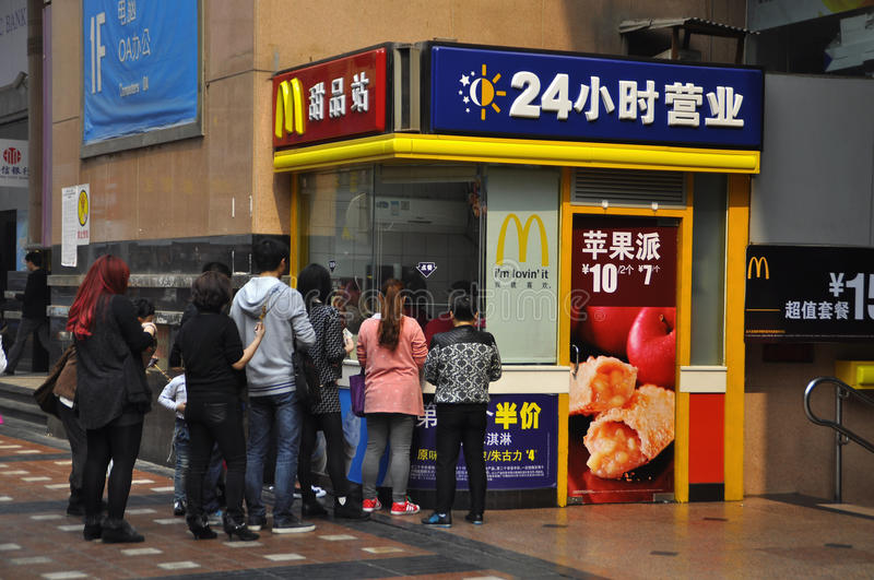 McDonald's in China. Line up to buy McDonald's dessert. The photo taken in Chongqing, March 18, 2014 stock photo