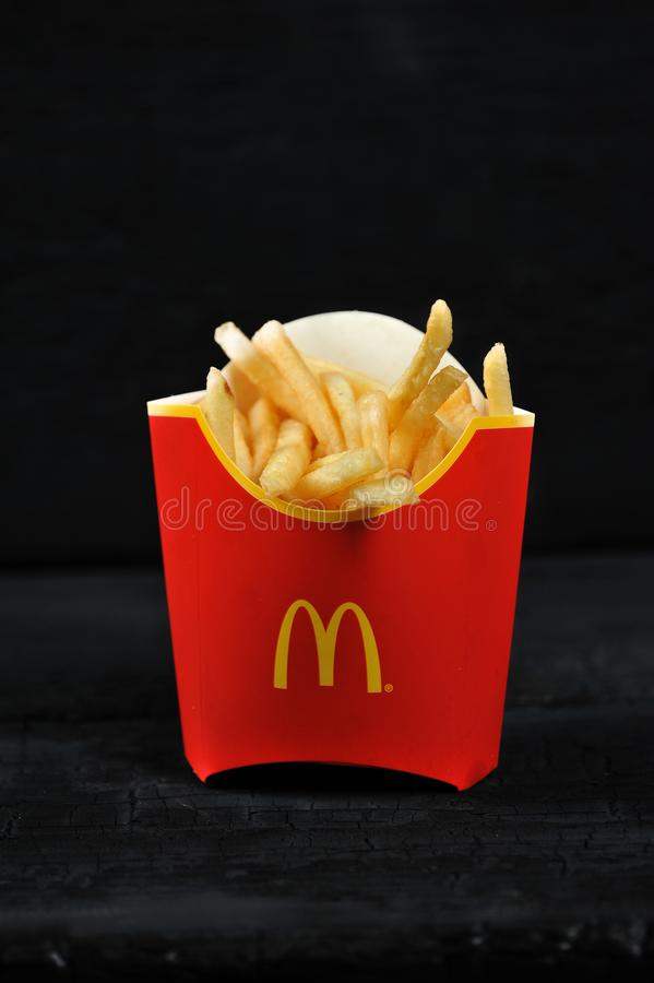 McDonald`s meal on rutic black background, includes French Fries royalty free stock image