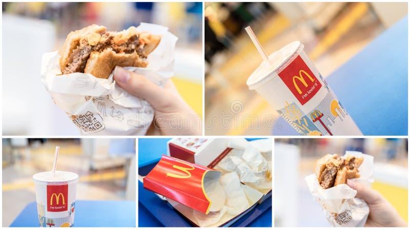 McDonalds汉堡包、汁液和残羹剩饭在快餐餐馆 免版税库存图片