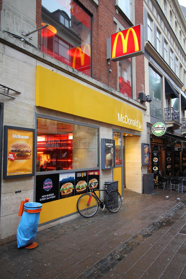 McDonalds fast food. COPENHAGEN - MARCH 10: McDonald's restaurant on March 10, 2011 in Copenhagen, Denmark. With 4.9bn USD announced net income (2010) it is the royalty free stock photography