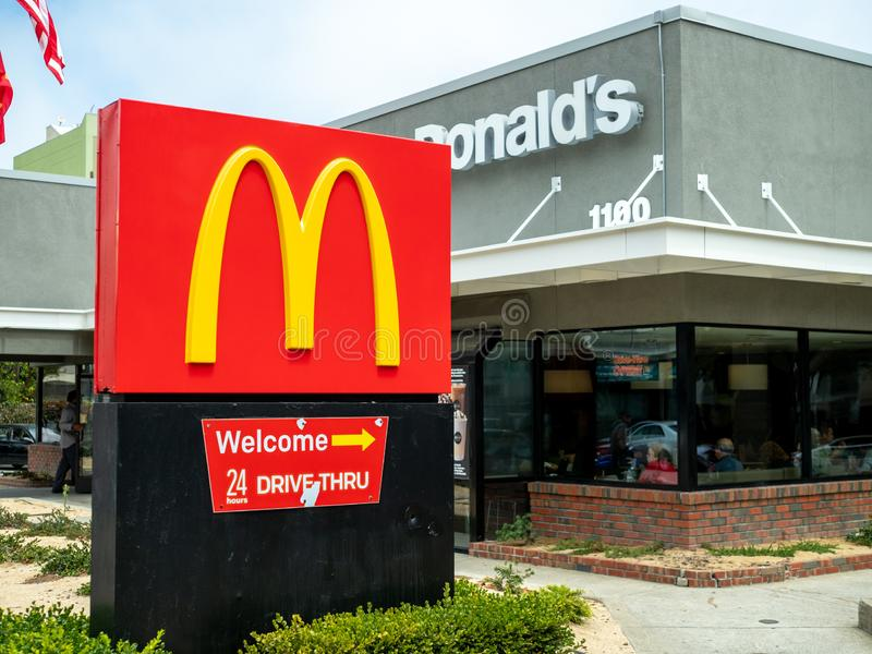 McDonalds logo, restaurant location and 24 hour drive through sign outside of remodeled location stock photo