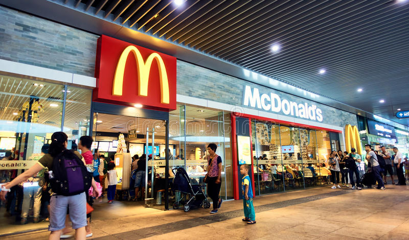 McDonalds. Front of McDonalds fast food restaurant with mcdonald golden arches store sign and logo in China stock image