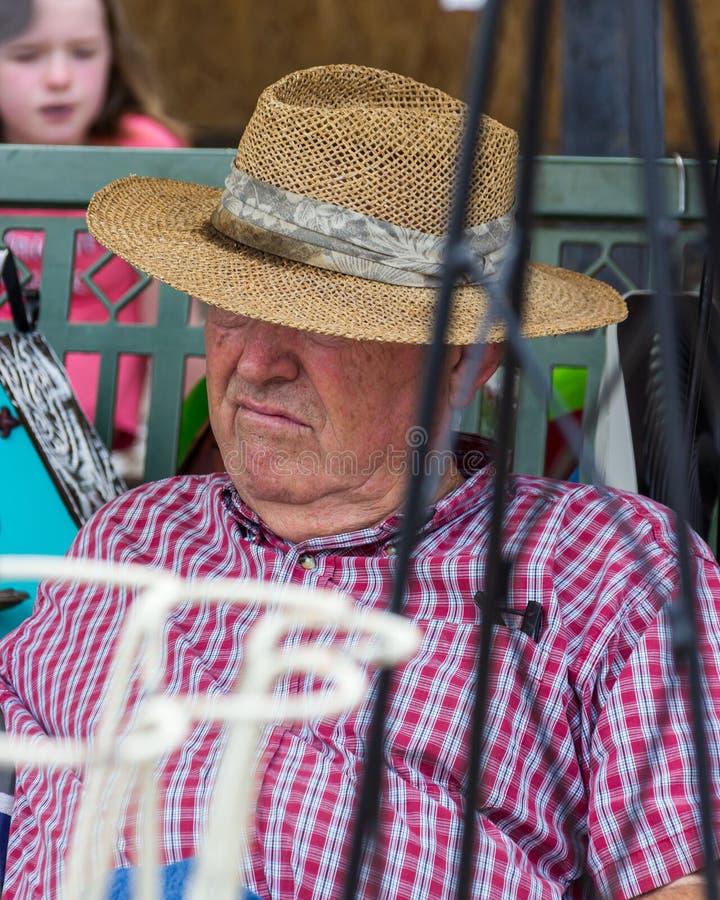 2019 McDonough, Georgia Geranium Festival - durmiendo en el trabajo imagen de archivo