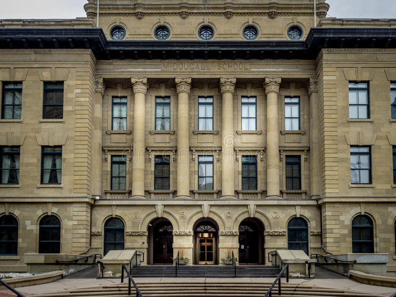 McDougall School building. The front facade of the McDougall School building on March 15, 2015 in Calgary, Alberta Canada. This old school building is now used stock photos