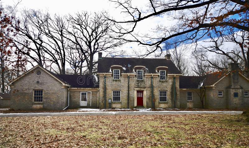 McKee House. This is a Winter picture of the iconic McKee House in Churchill Woods located in Glen Ellyn, Illinois in DuPage County. This two-story, stone stock image