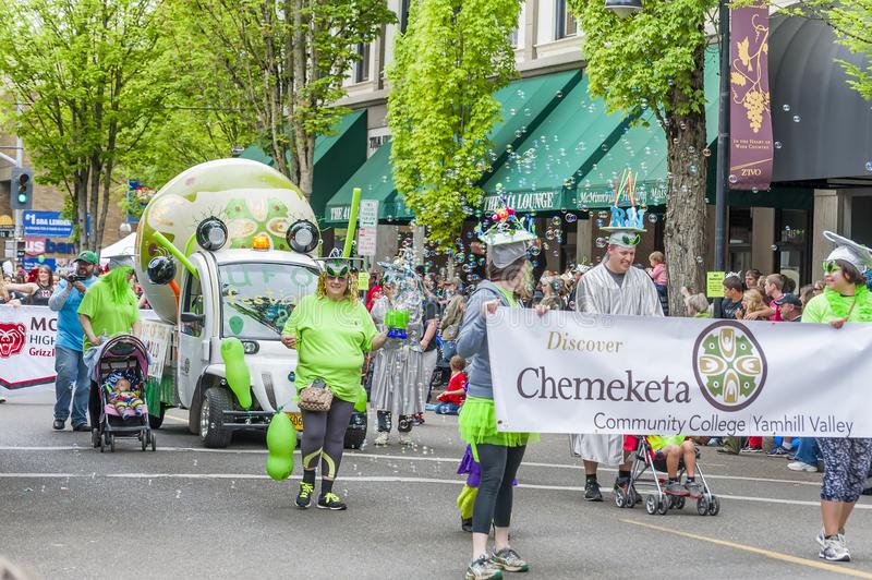 Annual UFO Festival in McMinnville Oregon. McMinnville, Oregon, USA - May 16, 2015: Chemeketa Community College float with tons of bubbles partake in the parade royalty free stock image