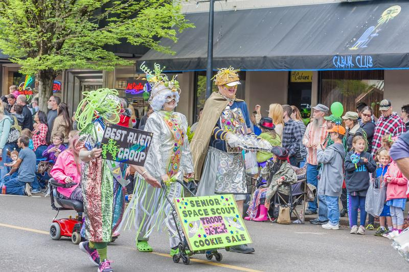 Annual UFO Festival in McMinnville Oregon. McMinnville, Oregon, USA - May 16, 2015: Elderly adults of the Alien Seniors Scouts walk down main street in the royalty free stock photos