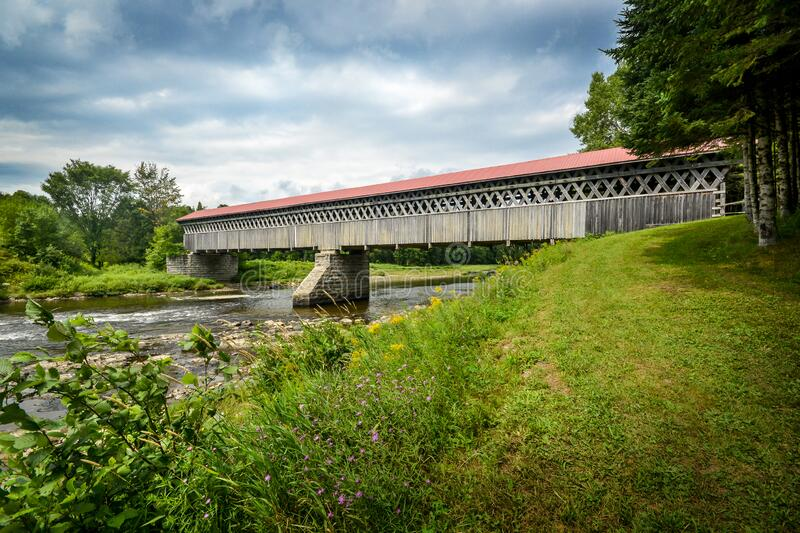 McVetty-McKenzie covered bridge made of wood and dating from 1893 is located in Gould, Lingwick, Estrie, Quebec Canada. McVetty-McKenzie covered bridge made of royalty free stock photography