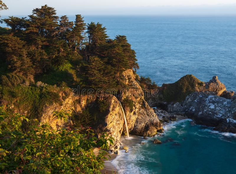 McWay Falls, Pacific Coast Highway, California, USA. McWay Falls catches the late day sunlight, along the Pacific Coast Highway in California royalty free stock photos