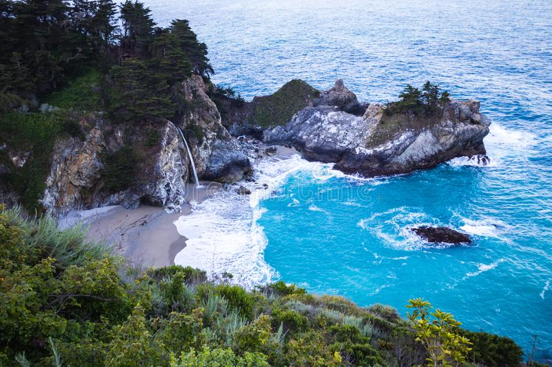 McWay Falls is a waterfall on the coast of Big Sur in central California that flows year-round from McWay Creek in Julia Pfeiffer royalty free stock image