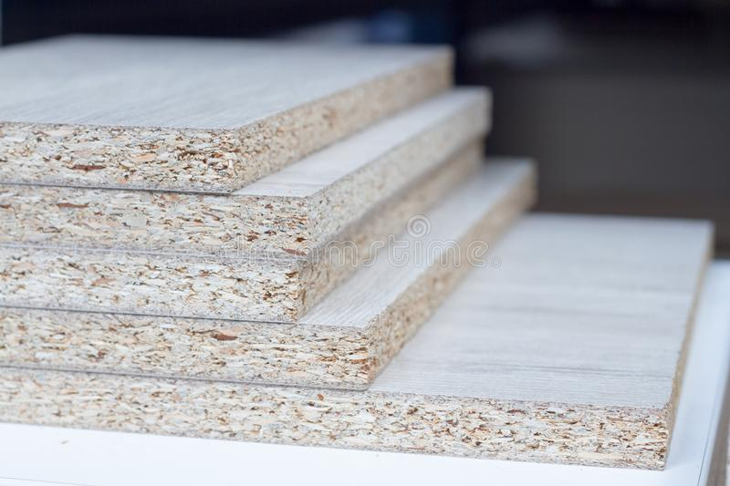 MDF, PARTICLE BOARD. Wood panels of different thicknesses and colors. royalty free stock photography