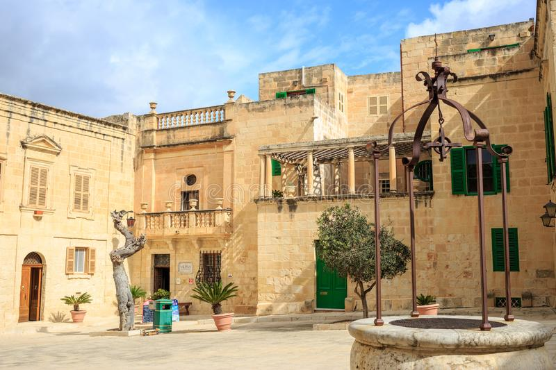 Mdina, Malta. Well at Misrah Mesquita square and traditional facade buildings background. stock images