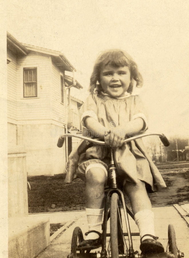 Me at age four. This picture was taken of me at age four on my new tricycle royalty free stock photography