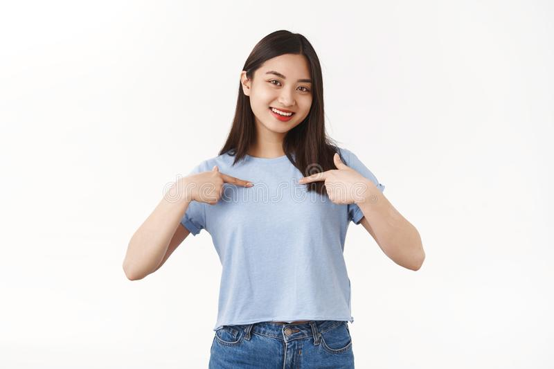 Me best candidate. Self-assured pretty asian brunette girl volunteering pointing herself boastful smiling delighted. Telling herself bragging own achievements royalty free stock photos
