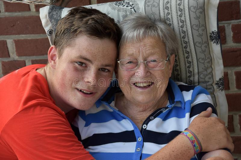 Me and grandma, boy takes care of his great-grandma stock images