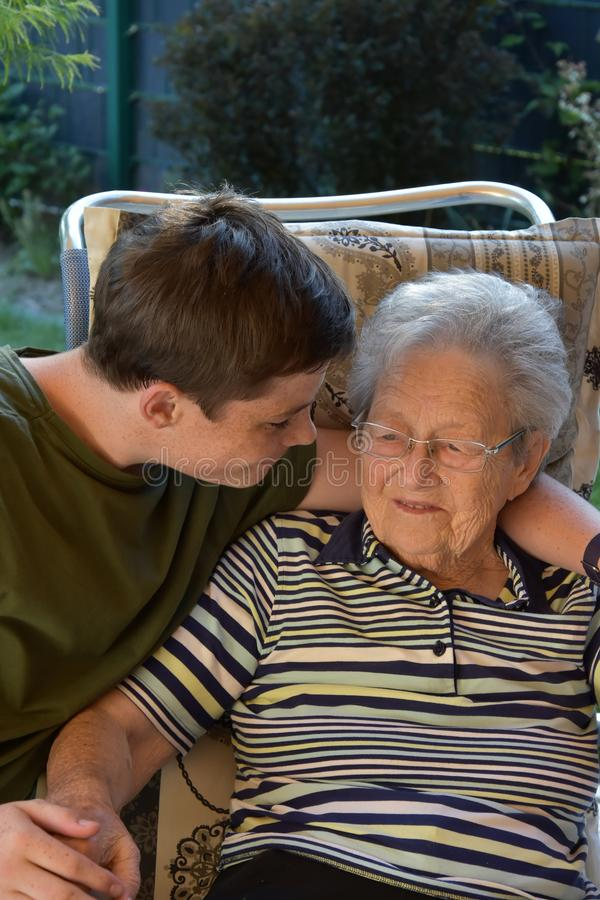 Me and grandma, boy visits his great-grandma royalty free stock image