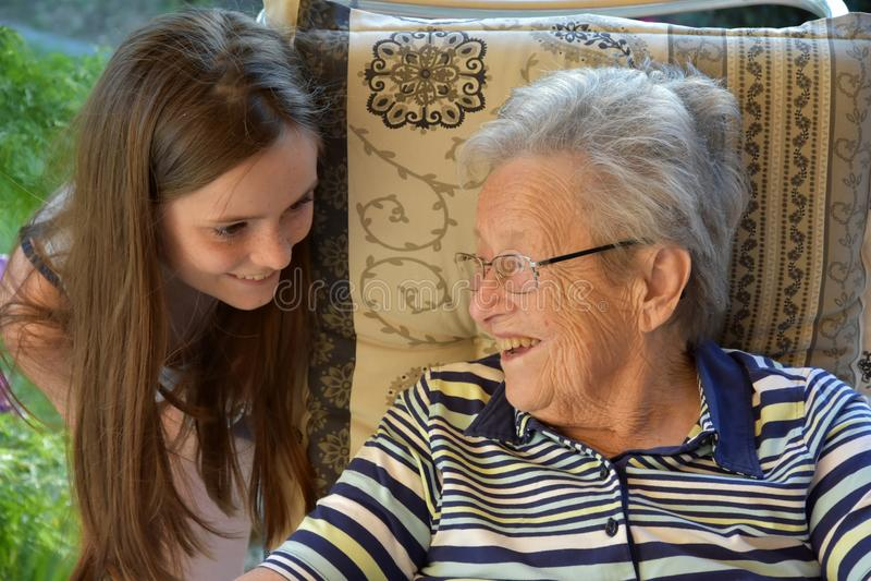 Me and grandma, girl surprises her great-grandma stock photo