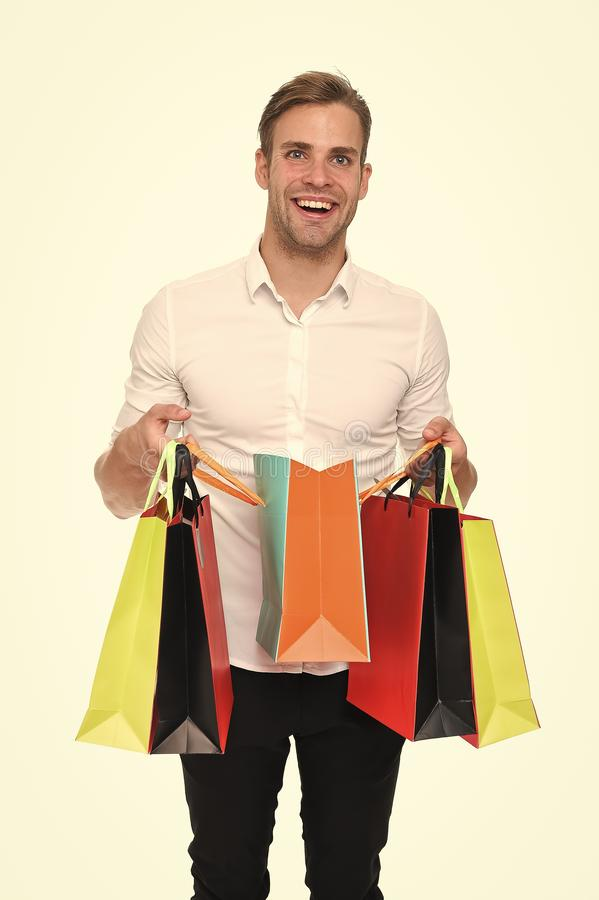 Is it for me. Guy satisfied got bag gift. Man happy received package gift isolated white. Birthday delivery. Guy. Celebrates birthday. Take advantage gifts royalty free stock photography