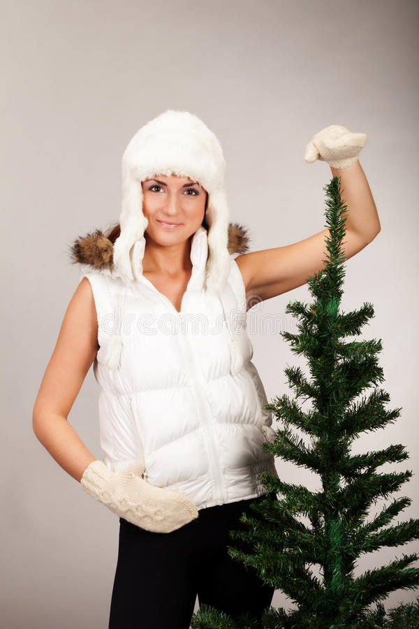 Me and my Christmas tree. Small fir tree means less work to decorate it royalty free stock image