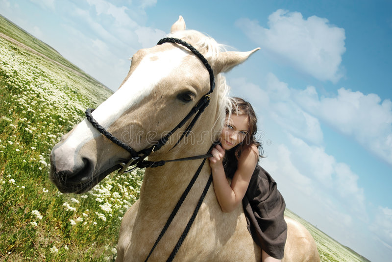 Me and my horse. Portrait of the smiling woman and horse outdoors royalty free stock photography